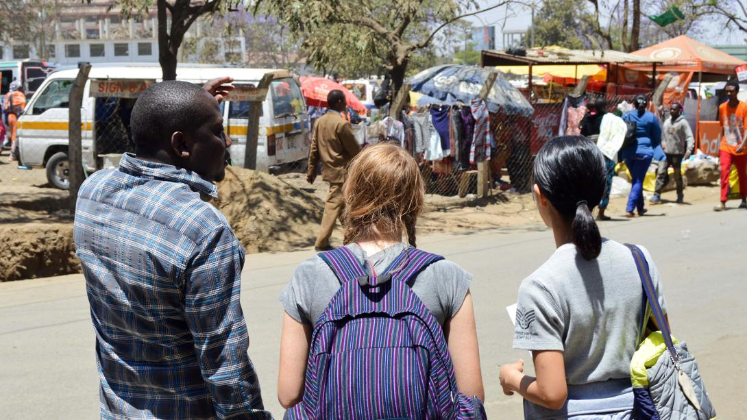 A local staff member shows Projects Abroad volunteers around on their first day of the English language course in Tanzania.